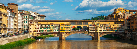 old bridge: Panorama view to ancient bridge Ponte Vecchio at river Arno in Florence old town, famous touristic place of Tuscany region, Italy