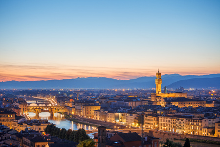 localities: Evening sunset over Florence with Ponte Vecchio bridge on Arno river and tower in Italy