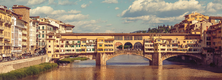 localities: Retro-styled panorama view to ancient bridge Ponte Vecchio at river Arno in Florence old town, famous touristic place of Tuscany region, Italy