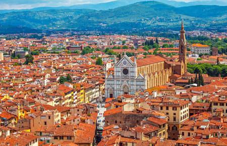 jewish houses: Great Synagogue of Florence top view to old town roofs and blue mountains on background, summer day panorama Stock Photo