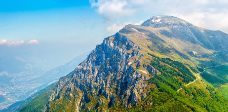 hillock: Picturesque view from hill Monte Baldo mountain to Altissimo above lake Garda. Veneto region, Italy