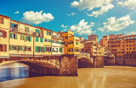 ponte vecchio: Vintage looking bridge with houses Ponte Vecchio in Florence old town, on Arno river. Famous touristic place in Italy