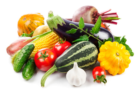 yield: Fresh vegetables autumnal harvest with green leaves, isolated on white background Stock Photo