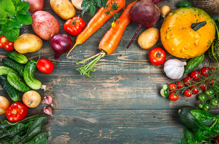 Harvest fresh vegetables autumn still-life on old wooden board in rustic style copyspace,