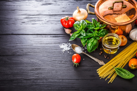 Italian food preparation pasta on wooden board in style copyspace,