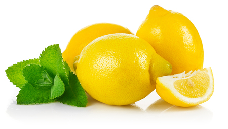 ration: Fresh fruit lemons in section with leaf green mint, isolated white background Stock Photo