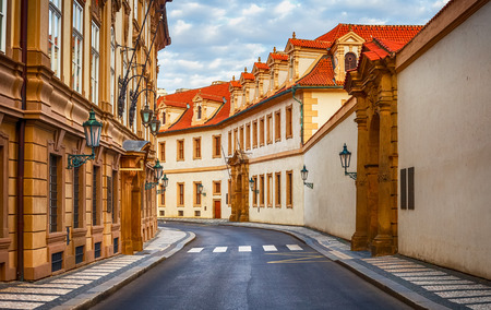 Deserted road at vintage street among old houses in old town Prague, Czech Republic.