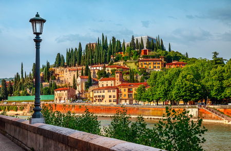 crone: Italy Verona old italian house on knoll panorama with bank river Adige embankment street lamp, Stock Photo