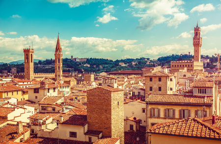 Florence Italy old town with houses tegular roofs and high tower on background blue sky vintage stylized,