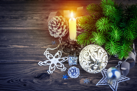 Christmas firtree with burning candle decoration pinecone holiday card new year still life on wooden boaard with copyspace Stock Photo
