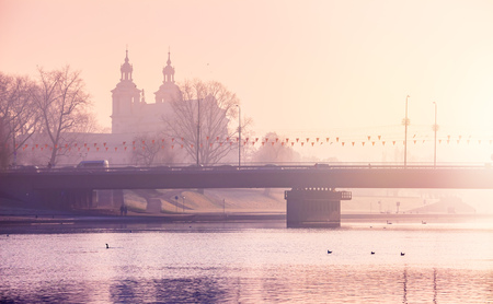 water town: Bridge on river wisla sunshine krakow poland foggy morning town sunrise over water,