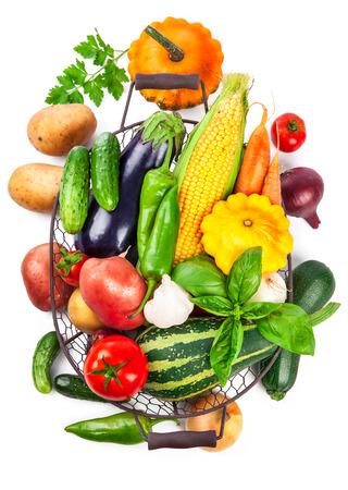 leaf vegetable: Fresh vegetable harvest in basket from leaf basil copyspace, isolated on white background