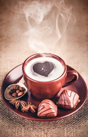 bracing: Cup fragrant hot coffee with bean chocolate sweet and loaf in vintage rustic style cinnamon steam smoke on wooden board for bracing morning breakfast.
