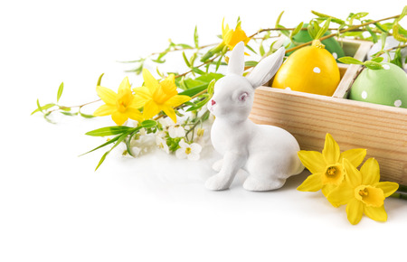 spring leaf: Easter rabbit eggs spring flowers narcissus branch green leaf greeting card copyspace, isolated on white background. Stock Photo