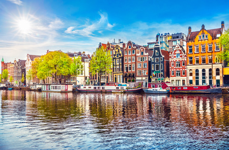Amsterdam Netherlands dancing houses over river Amstel landmark in old european city spring landscape. Banco de Imagens