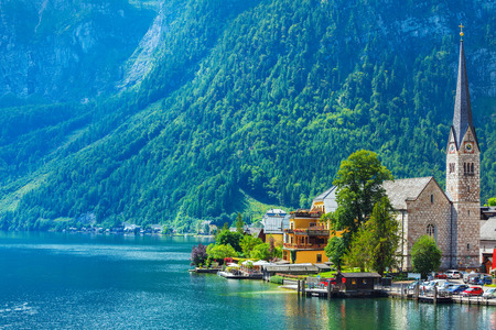 crone: Chapel in Hallstatt old town famous landmark Austria on lake Hallstattersee among Austrian Alps mountains with green forests.