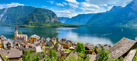 locality: Hallstatt old town panoramic view Austria on lake Hallstattersee among mountains Austrian Alps top. Stock Photo