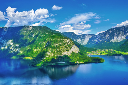 Panoramic view on Austrian mountains Alps lake Hallstattersee blue sky with white cloud scenic landscape. Stock Photo