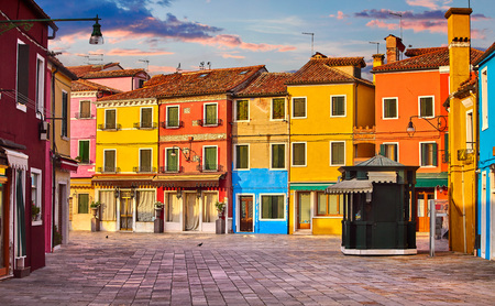 Bright coloured houses on Burano island Venice Italy with blue sky and clouds. Stock Photo