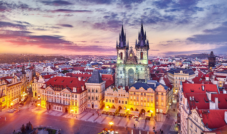 Church of our lady before tyn on Old Town Square Prague Czech republic with red roof sunset sky and top view.