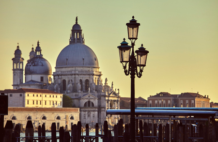 Cathedral of Santa Maria della salute street lamp on embankment in Venice sunset Italy.