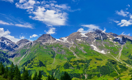 Panoramic view at Pasterze Glacier Grossglockner among austrian Alps mountains summits blue sky clouds. Stock Photo