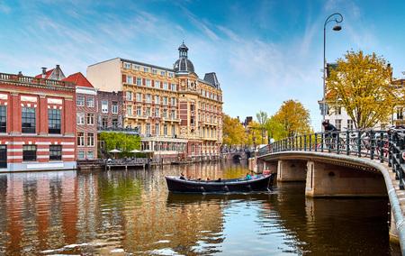 Channel in Amsterdam Netherlands houses river Amstel landmark old european city spring landscape. Stock Photo