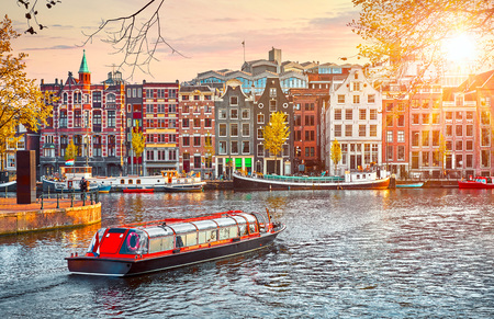 Channel in Amsterdam Netherlands houses river Amstel landmark old european city spring landscape. Foto de archivo