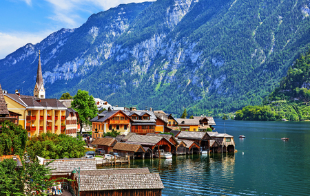 Antique famous village at Hallstattersee lake among Alpine Austrian mountains with green forests. Reklamní fotografie
