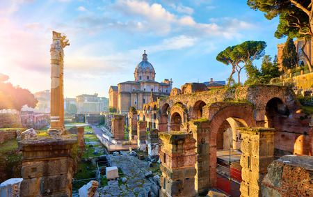Roman Forum in Rome, Italy. Antique structures with columns and archs. Wrecks of ancient italian roman town.