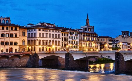 Panorama view to ancient bridge at river Arno in Florence old town, famous touristic place of Tuscany region, Italy.