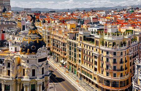 Madrid, Spain. Famous streets Gran Via and Calle de Alcala crossroads in Downtown. Top view to the classic Spanish buildings architecture.