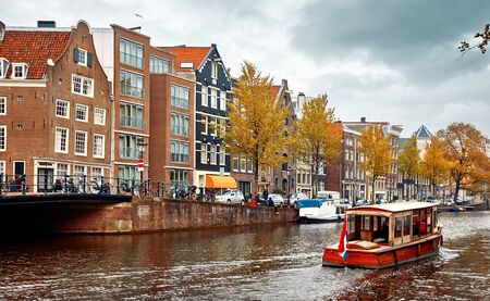 Amsterdam, Netherlands. Floating Houses and houseboats and boats at channels by banks. Stockfoto
