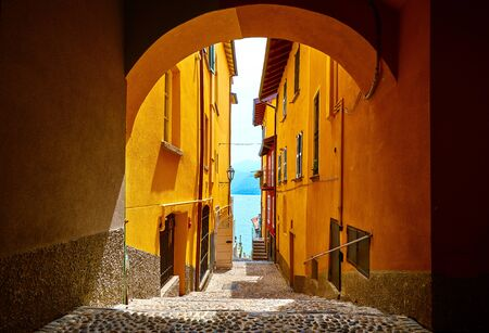 Varenna, Italy. Vintage narrow street of old Mediterranean town at lake Como in Lombardy region. Stockfoto
