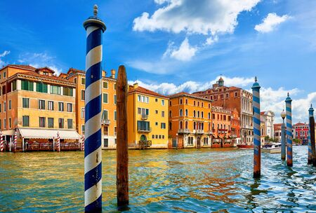 Venice, Italy. High-speed water motorboat floating by at Grand Canal vintage street among old italian houses with piers pillars. Stockfoto - 129272148