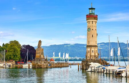 Old lighthouse with clock in bay. Stockfoto - 129272483