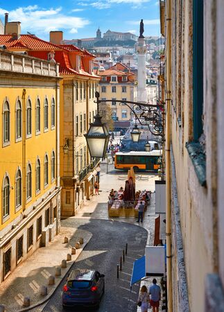 Lisbon, Portugal. Day streets with road under street lamps on walls Stockfoto
