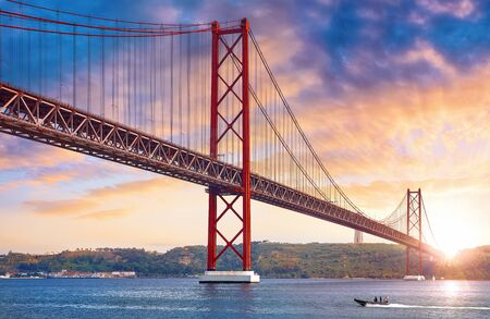 25th April Bridge in Lisbon, Portugal. Famous landmark on river Tagus.