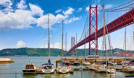 25th April Bridge in Lisbon, Portugal. Famous landmark on river Tagus. Stockfoto - 129272523