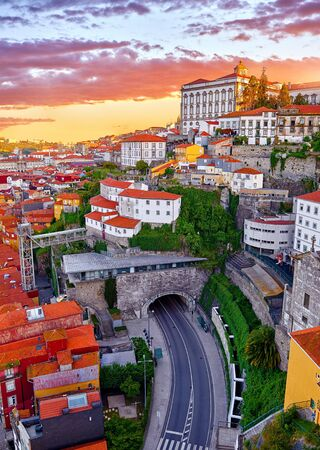 Porto, Portugal. Top view aerial cityscape panorama of old town during beautiful evening sunset.