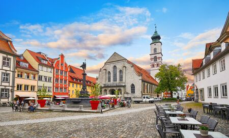 Square old town with authentic traditional house tower from church and paving stones. Stockfoto - 130832235