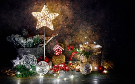Christmas holiday decoration with shining star, fir, snow, balls and vintage toys with garland.