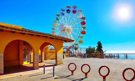 Entrance in amusement park at Mount Tibidabo Barcelona Spain with Ferris wheel attraction. Ticket office building. Stok Fotoğraf