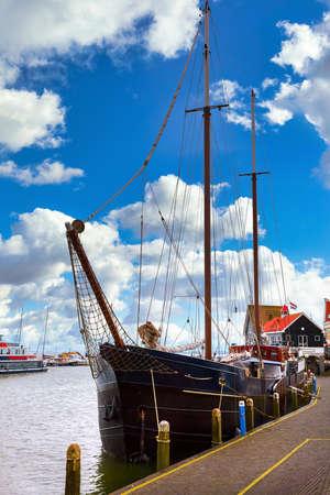 Volendam, Netherlands. Luxury yachts parked by pier in bay of North Sea.