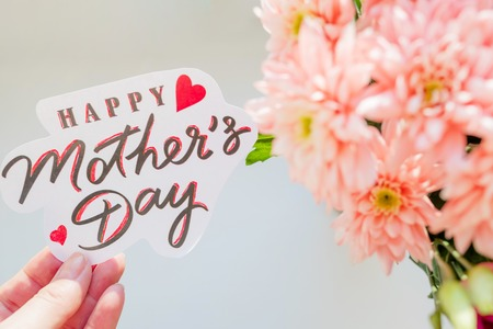 Happy Mothers day card. Greeting Card with Spring Bouquet.Pink chrysanthemum flowers.Happy Mothers Day Pastel Candy Colors Background. Floral mothers day flat lay minimal concept. Selective focus