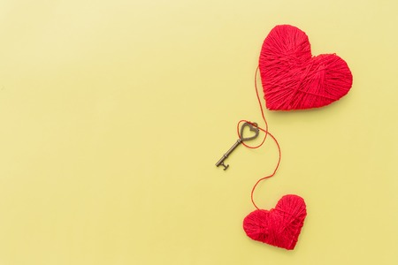 Key for lovers.happy Valentine day.hearts bound by one thread, red heart, recognition in love, emotion.Love concept with hearts.Set for craft.two decorative hearts made of thread, with a small key.Copy space