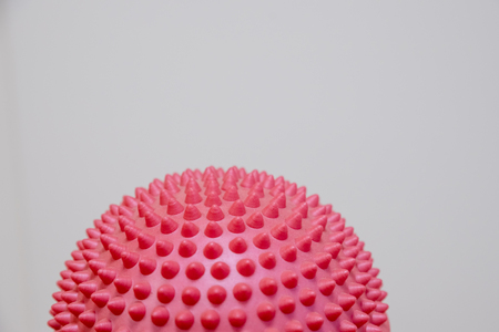 Spiky massage ball isolated on the white background.Flat feet correction exercise.half balance massage balls. rubber ball for self massage, reflexology and myofascial release.therapeutic exercise.Copy space