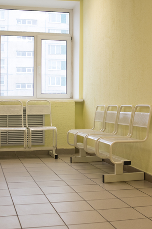 Seat waiting for the doctor in the hospital.Empty and clean waiting area with metallic chairs in clinic. in an corridor there is a waiting room. Lobby room in the hospital.
