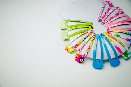 stylish fashion hair accessories for girls, baby. Spring colors. Glamor girl, creative look with trendy hair style, hair clips on pink background. Copy space. Reklamní fotografie
