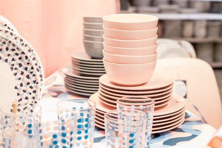 dishes tableware supermarket variety.Department store. Porcelain, dishes. Pastel colors for plates and glasses.View of beautiful plates on supermarket shelf.Big choice Foto de archivo - 119730531